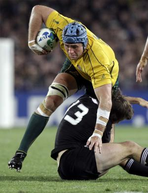 Australia's James Horwill is tackled by New Zealand All Blacks Conrad Smith during their Rugby World Cup semifinal at Eden Park in Auckland, Sunday, Oct. 16, 2011. (AP Photo/Themba Hadebe)