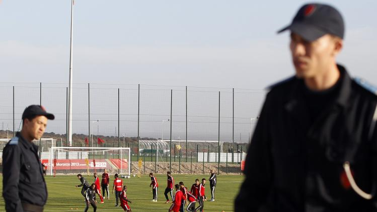 Moroccan policemen ask the media to stop recording the training session of Egypt's Al Ahly in Agadir