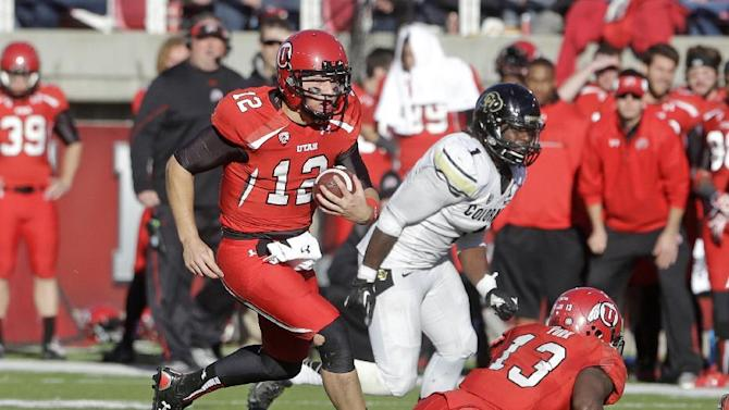 Utah quarterback Adam Schulz (12) carries the ball as Colorado linebacker Derrick Webb (1) pursues in the fourth quarter of an NCAA college football game Saturday, Nov. 30, 2013, in Salt Lake City. Utah won 24-17