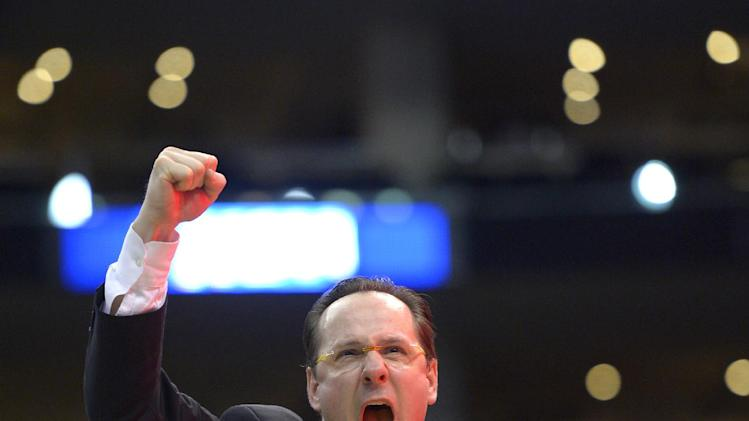 Wichita State coach Gregg Marshall celebrates after Wichita State defeated Ohio State 70-66 in the West Regional final in the NCAA men's college basketball tournament, Saturday, March 30, 2013, in Los Angeles. (AP Photo/Mark J. Terrill)