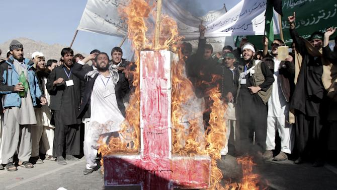 Afghan students of Nangarhar University burn a Christian cross and the flags of the U.S. and Israel,  during a protest against Israel's recent offensive in Gaza,  on the outskirts of Jalalabad, east of Kabul, Afghanistan, Monday, Nov. 26, 2012. (AP Photo/Rahmat Gul)