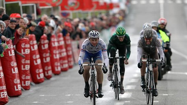 Francaise Des Jeux's tean Pierrick Fedrigo (L), sprints on the finish line of the 74th edition of the Paris-Camembert cycling race on April 9, 2013 in Vimoutiers, northwestern France. Fedrigo won the race ahead of AG2R La Mondiale's team Sylvain Georges (