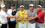 Nay Bala Win Myint and Yan Naing Phyoe of Myanmar (right) hold the trophy for the Zaykabar Myanmar Open at the Royal Mingalardon Golf and Country Club in Yangon. After decades in the shadows, Myanmar's sudden opening-up to the outside is shining a new light on the country -- and revealing, amongst other things, one of Asia's most vibrant golf communities