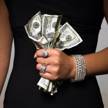 Woman-gripping-one-hundred-dollar-bills_web