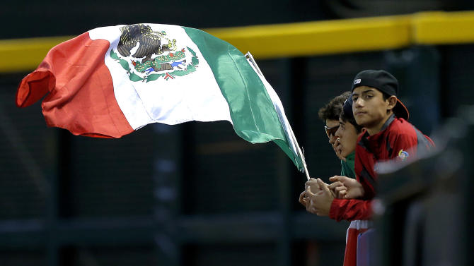 Mexico fans wave their country's flag during the second inning of a World Baseball Classic game against Canada, Saturday, March 9, 2013, in Phoenix. (AP Photo/Matt York)
