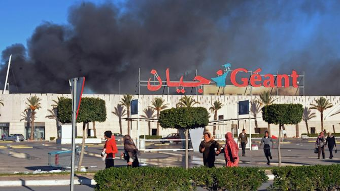 A supermarket is on fire after it was sacked and looted in Bizerte, Tunisia, Saturday, Jan. 15, 2011. The Tunisian capital's main train station has been burned to the ground, and shops have been sacked and looted in violence that came after the North African nation's president fled the country. (AP Photo/Hassene Dridi)
