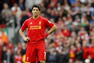 Brendan Rodgers does not believe Luis Suarez, pictured, will be driven out of England by the criticism directed towards him