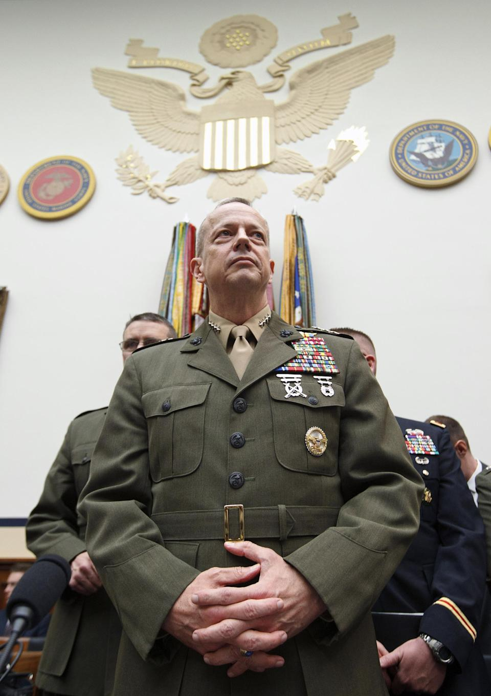 Marine Gen. John Allen, the top U.S. commander in Afghanistan arrives on Capitol Hill in Washington, Tuesday, March 20, 2012, to testify before the House Armed Services Committee hearing on Afghanistan. (AP Photo/J. Scott Applewhite)