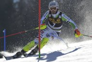 Fritz Dopfer of Germany clears a gate during the first run of the Alpine Skiing World Cup men's slalom ski race in Kranjska Gora March 9, 2014. REUTERS/Srdjan Zivulovic (SLOVENIA - Tags: SPORT SKIING)