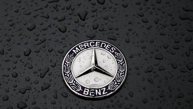 The logo of German car manufacturer Mercedes-Benz, a subsidiary of Daimler AG, is pictured covered with raindrops at a Mercedes-Benz branch in Frankfurt