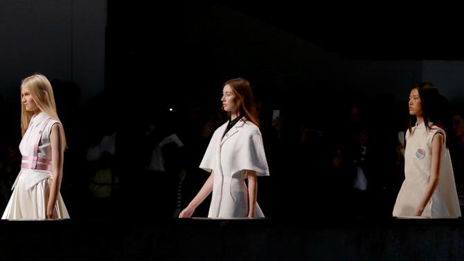 Models shows  creations by Serbian-born fashion designer Nana Aganovich as part of the spring-summer 2013 ready to wear collection, during Paris Fashion week, Tuesday, Sept. 25, 2012. (AP Photo/Jacques Brinon)