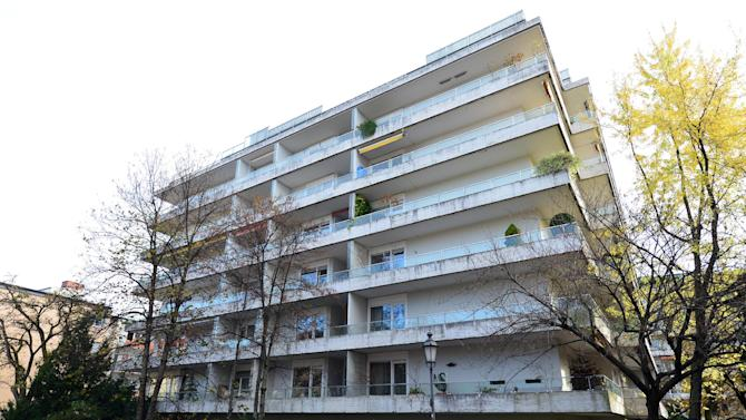 FILE - In this Nov. 4, 2013 file photo cars are parked outside the apartment building in Munich, Germany, where more than 1,400 artworks were found in the apartment of collector Cornelius Gurlitt. Gurlitt, a reclusive German collector whose long-secret hoard of well over 1,000 artworks triggered an international uproar over the fate of art looted by the Nazis, died Tuesday, May 6, 2014. He was 81. (AP Photo/dpa, Marc Mueller, File)