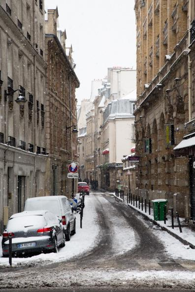 PARIS, FRANCE - JANUARY 19: Snow covers the streets on January 19, 2013 in Paris, France. Heavy snowfall fell throughout Europe and the UK causing travel havoc and white layers of pretty scenery. (Pho