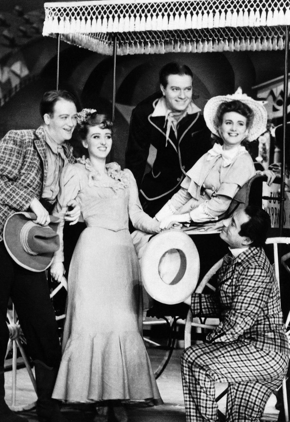 "FILE -  In a 1943 file photo, from left, Lee Dixon, Celeste Holm, Alfred Drake, Joan Roberts and Joseph Buloff are seen in the original production of ""Oklahoma!""  Holm, who soared to Broadway fame in ""Oklahoma!"" died Sunday July 15, 2012, a relative said. She was 95.      (AP Photo)"