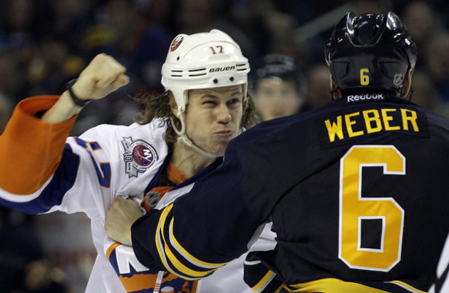 Martin fighting Sabres' defenseman Mike Weber. Courtesy of Yahoo! Sports
