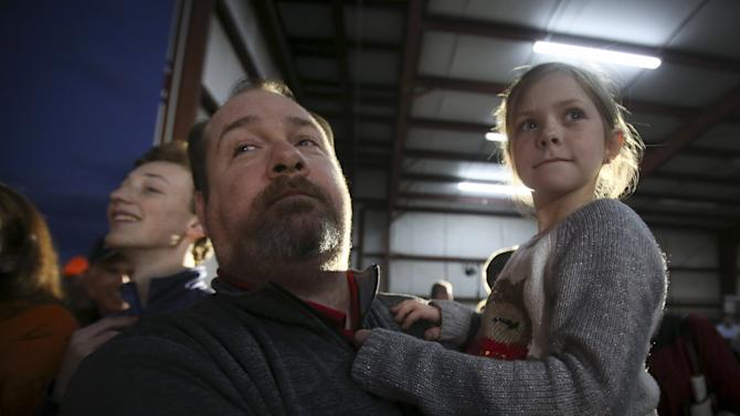 Pearson and his daughter watch U.S. Republican presidential candidate Rubio during a campaign event in an airport hanger in Greenville