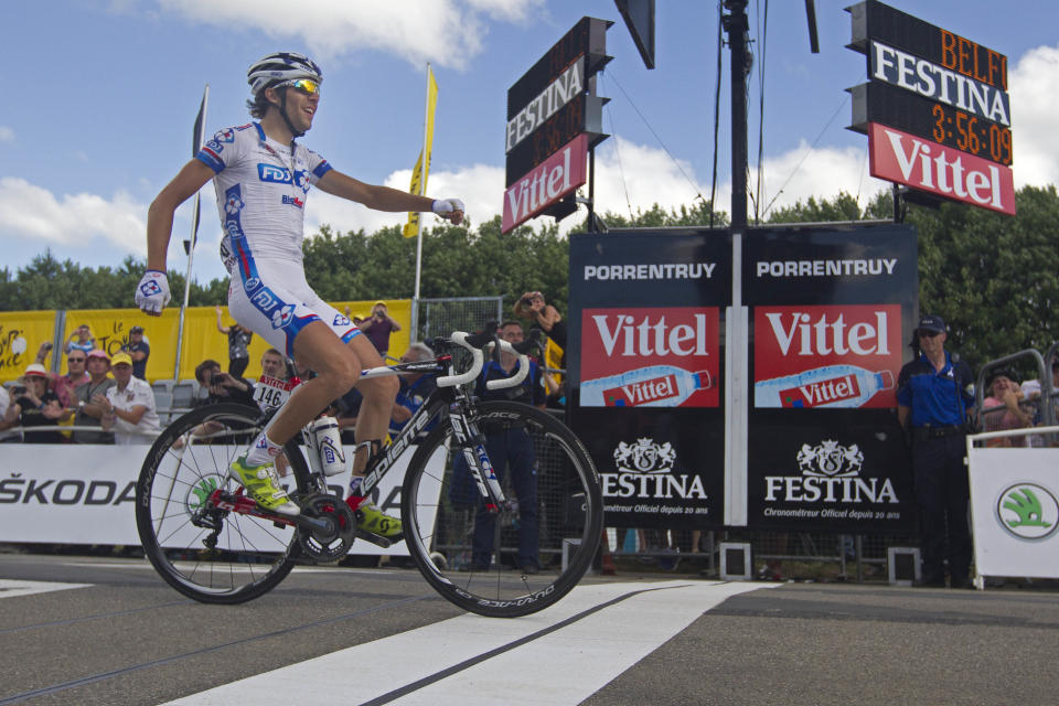 Thibaut Pinot of France crosses the finish line to win the 8th stage of the Tour de France cycling race over 157.5 kilometers (98.5 miles) with start in Belfort, France, and finish in Porrentruy, Switzerland, Sunday July 8, 2012. (AP Photo/Peter Dejong)