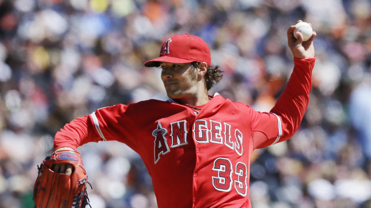 Los Angeles Angels starting pitcher C.J. Wilson throws during the second inning of a baseball game against the Detroit Tigers in Detroit, Saturday, April 19, 2014. (AP Photo/Carlos Osorio)
