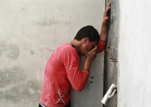 A Palestinian mourns during the funeral of a gunman in Gaza