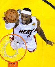 The Miami Heat's LeBron James goes to the hoop against Oklohoma City Thunder in the fifth game of the NBA Finals at the American Airlines Arena in Miami, Florida. Miami won the series 4-1