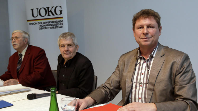 Rainer Wagner, chairman of the victims' group UOKG, the Federal Commissioners of the government's institute for checking the former East German intelligence papers, Roland Jahn, and Peter Betzel, the head of Ikea Germany, from left, wait for the start of a joint news conference in Berlin, Germany, Friday, Nov. 16, 2012. Swedish furniture giant Ikea expressed regret Friday that it benefited from the use of forced prison labor by some of its suppliers in communist East Germany more than two decades ago. (AP Photo/Michael Sohn)