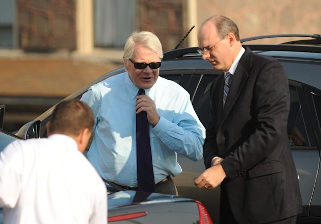 Prosecutor Joseph E. McGettigan III, center, arrives at the Centre County Courthouse with the rest of his prosecution team, in Bellefonte, Pa., Wednesday, June 20, 2012 for former Penn State Universit