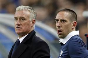 France's Ribery stands next to coach Deschamps before entering the field during their international friendly soccer match against the Netherlands at the Stade de France in Saint-Denis near Paris