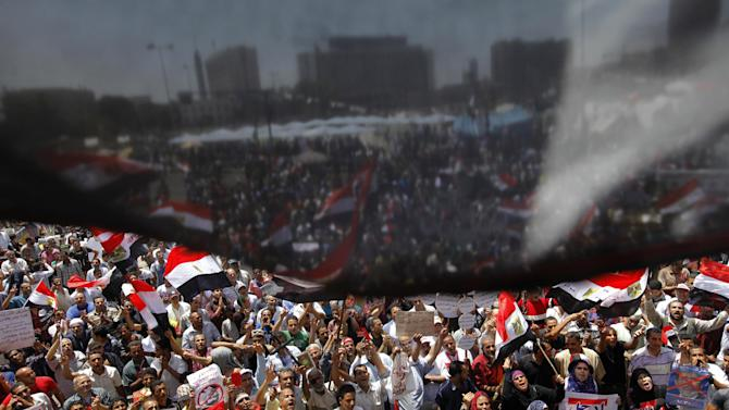 Opponents of Egypt's Islamist President Mohammed Morsi wane national flags as they demonstrate in Tahrir Square in Cairo, Egypt, Friday, June 28, 2013. Thousands of supporters of Egypt's embattled president are rallying in the nation's capital in a show of support ahead of what are expected to be massive opposition-led protests on June 30 to demand Mohammed Morsi's ouster.(AP Photo/Amr Nabil)