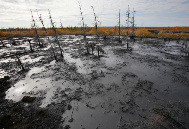 In this Saturday, Sept. 10, 2011 photo an oil spill seen near the town of  Usinsk, 1500 km (930 miles) northeast of Moscow, Russia.  Komi is one of Russia's largest and oldest oil provinces but ruptur