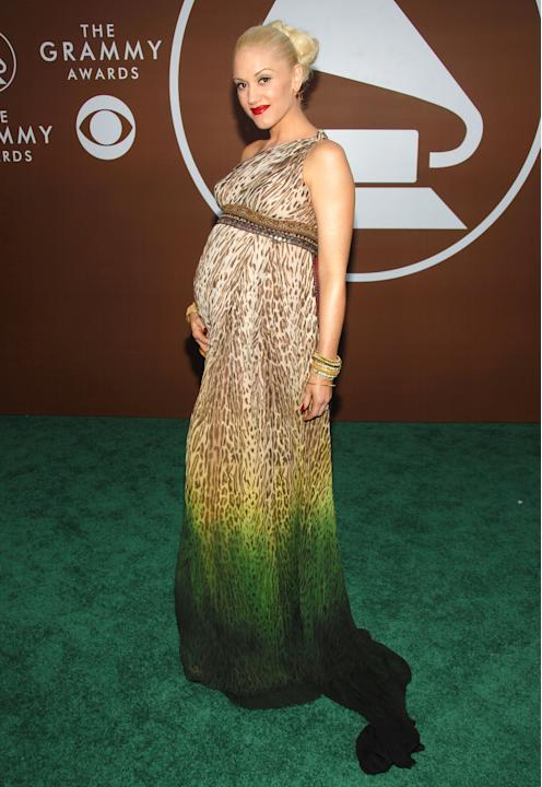 Behold the miracle of pregnant punk princess Gwen Stefani in 2007 in her own L.A.M.B. design. This look is everything the GRAMMYs should be (again, pulled off by a PREGNANT woman): funky, sexy, and ri