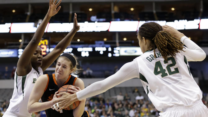 Baylor guard Kimetria Hayden (1) and center Brittney Griner (42) defend against a drive by Oklahoma State forward Liz Donohoe (4) in the second half of an NCAA college basketball game in the Big 12 women's tournament Sunday, March 10, 2013, in Dallas. Donohoe had 20-points in the 77-69 loss to Baylor.  (AP Photo/Tony Gutierrez)