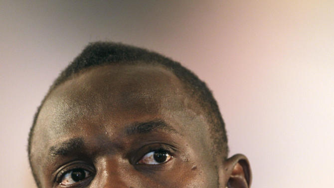 Olympic and world 100-meter record holder Usain Bolt, of Jamaica, speaks during a press conference in a Rome hotel, Tuesday, May 24, 2011. Bolt will make his season debut in Thursday's Golden Gala meet in Rome, his first race since getting beat by Tyson Gay in Stockholm last August to end his two-year unbeaten streak. (AP Photo/Pier Paolo Cito)