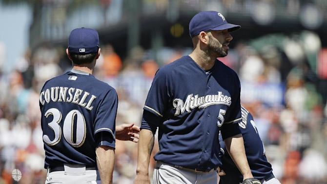 Five-run inning lifts Giants past Brewers