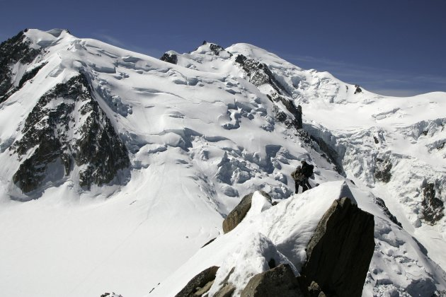 This June 1, 2005 file picture shows alpinists on the Arete Cosmique with a view of the north side of Mont Blanc du Tacul, left, the Mont Maudit, center, and the Mont Blanc, right. An avalanche in the