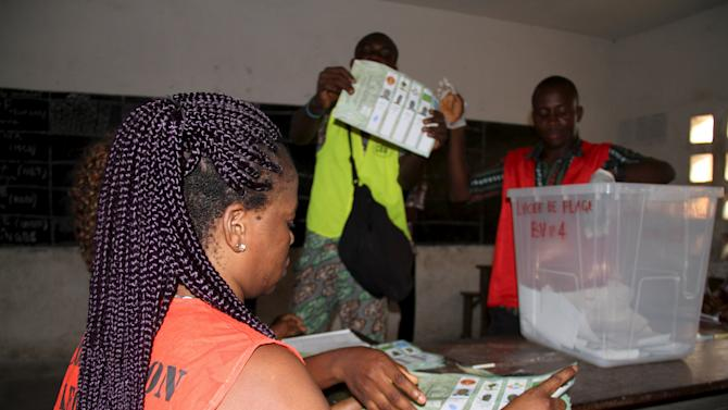 Election workers count votes of the 2015 presidential elections of Togo, in Lome