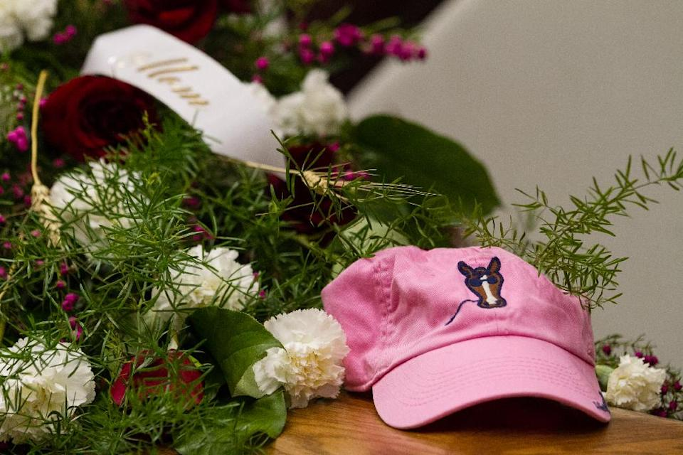 Sherry Arnold's hat rests on her casket during the funeral service in Sidney, Mont. on Friday, March 30, 2012. Arnold, a high school teacher, was kidnapped and murdered after disappearing in January. (AP Photo/Williston Herald, Elijah Nouvelage)
