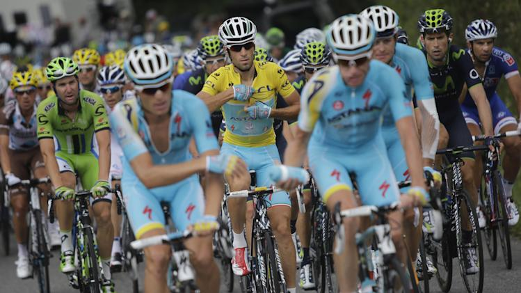 Italy's Vincenzo Nibali, closes the overall leader's yellow jersey, during the eighteenth stage of the Tour de France cycling race over 145.5 kilometers (90.4 miles) with start in Pau and finish in Hautacam, Pyrenees region, France, Thursday, July 24, 2014. (AP Photo/Laurent Cipriani)