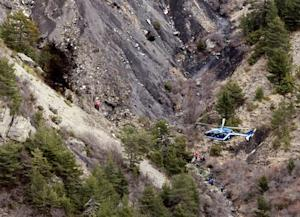 A French gendarme helicopter flies over the crash site …