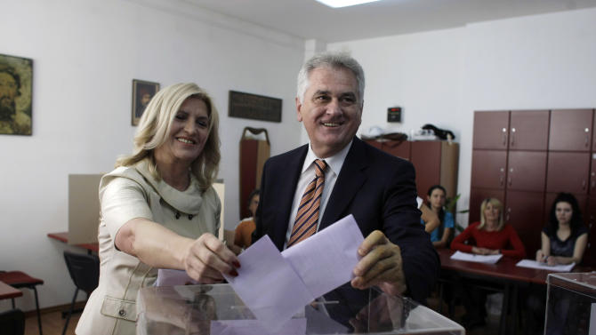 The nationalist Serbian Progressive Party leader and presidential candidate  Tomislav Nikolic, right, and his wife Dragica cast their ballots at a polling station in Belgrade, Serbia, Sunday, May 6, 2012. Serbia, a landlocked nation of 7.1 million people in southeast Europe, is holding presidential, parliamentary and municipal elections Sunday. Whoever wins could affect Serbia's future relations with the European Union as well as Kosovo, a one-time province whose declaration of independence Serbia has refused to accept. (AP Photo/ Marko Drobnjakovic)