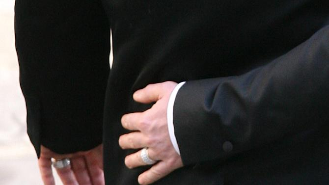 File picture of David Furnish, wearing a wedding ring, clasping the waist of his partner Elton John, after their civil ceremony in Windsor