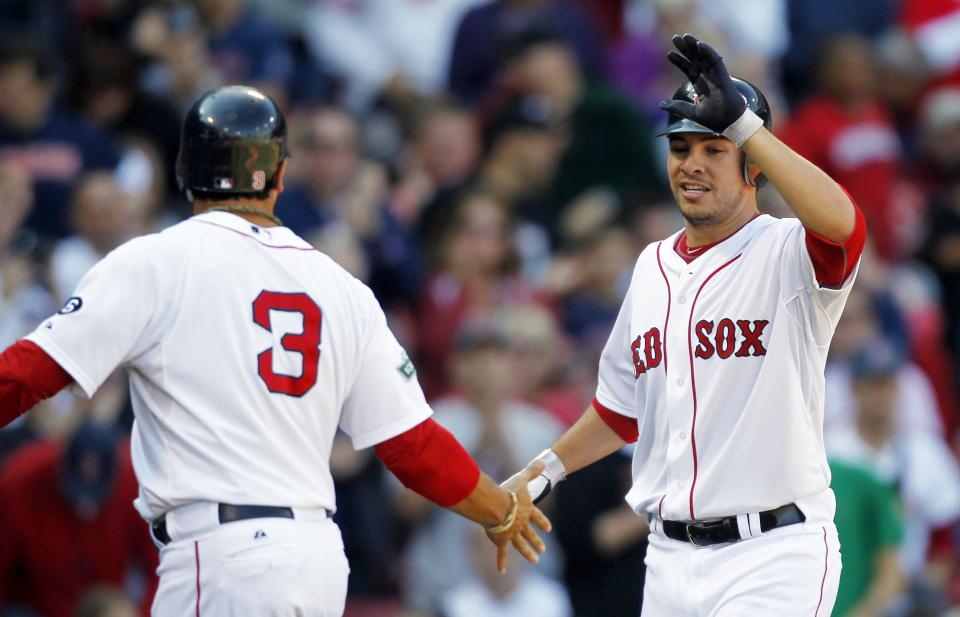 Boston Red Sox's Danny Valencia, right, celebrates his two-run home run that drove in Mike Aviles (3) in the fourth inning of a baseball game against the Baltimore Orioles in Boston, Saturday, Sept. 22, 2012. (AP Photo/Michael Dwyer)