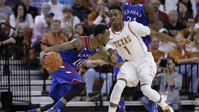 Kansas' Naadir Tharpe (10) looks to get past Texas' Isaiah Taylor (1) during the first half of an NCAA college basketball game, Saturday, Feb. 1, 2014, in Austin, Texas