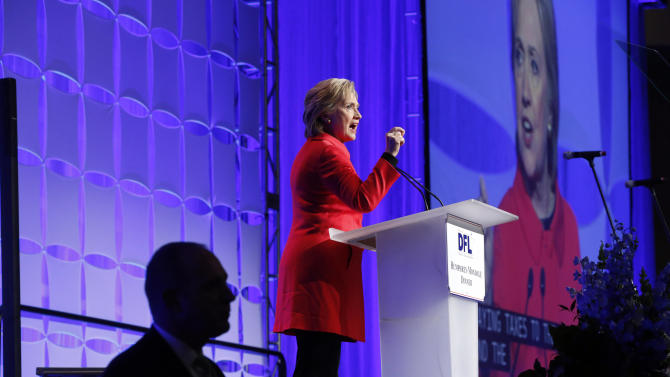 Democratic presidential candidate, Hillary Clinton acknowledges the crowd as she arrives to speak at the state's Democratic-Farmer-Labor (DFL) Humphrey-Mondale dinner, Friday, Feb. 12, 2016, in St. Paul, Minn  (AP Photo/Jim Mone)