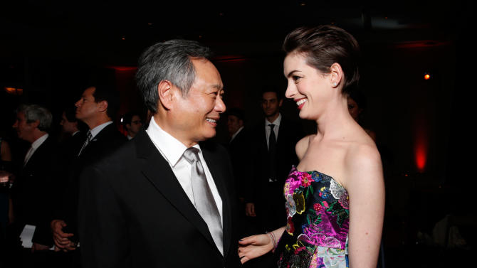 IMAGE DISTRIBUTED FOR THE PRODUCERS GUILD - Ang Lee, left, and Anne Hathaway speak during the cocktail reception at the 24th Annual Producers Guild (PGA) Awards at the Beverly Hilton Hotel on Saturday Jan. 26, 2013, in Beverly Hills, Calif. (Photo by Todd Williamson/Invision for The Producers Guild/AP Images)