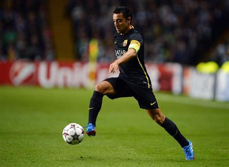Barcelona's Xavi Hernandez runs with the ball during their Champions League soccer match against Celtic at Celtic Park in Glasgow