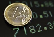 Picture illustration shows a one euro coin on a flat screen displaying exchange rates in Rome