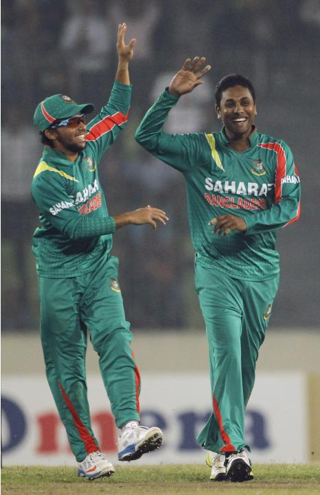 Bangladesh's Haque congratulates Gazi after he dismissed New Zealand's Neesham successfully during their second one-day international cricket match in Dhaka