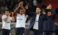 (left to right) Steven Caulker, Tom Huddlestone, Clint Dempsey and Mousa Dembele celebrate Tottenham's win against Manchester United on Saturday. Premier League victory over Manchester United in 27 attempts on the weekend