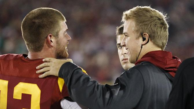 Southern California quarterback Matt Barkley, right, comes up to quarterback quarterback Max Wittek, left, after his first offensive drive of the game during the first half of an NCAA college football game against Notre Dame, Saturday, Nov. 24, 2012, in Los Angeles. (AP Photo/Danny Moloshok)