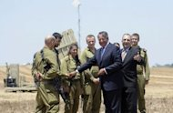 US Secretary of Defence Leon Panetta greets Israeli soldiers during a visit the site of an Iron Dome rocket launcher near the southern city of Ashkelon
